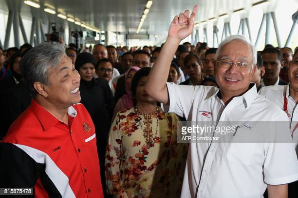 Malaysia's Prime Minister Najib Razak gestures as his Deputy Prime Minister Ahmad Zahid Hamidi smiles after arriving at Kajang station for the...