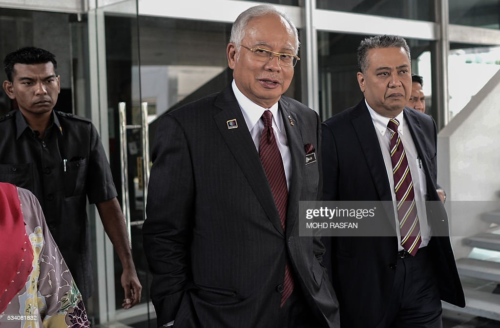 Malaysia's Prime Minister Najib Razak leaves his office at the parliament in Kuala Lumpur on May 25, 2016. Swiss financial regulators approved on May 24 the dissolution of Lugano-based BSI Bank over its links to a corruption scandal engulfing Malaysia's Prime Minister Najib Razak. / AFP / MOHD