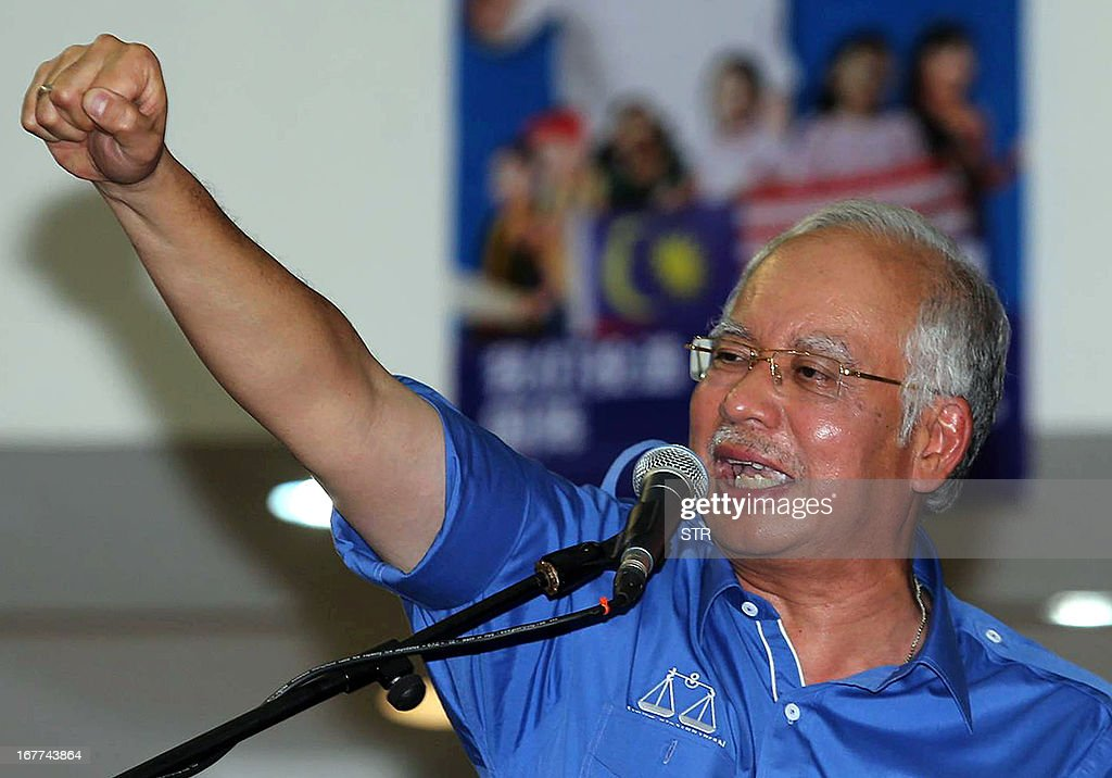Malaysia's Prime Minister Najib Razak, president of the ruling party National Front, shouts slogans during a party campaign event ahead of general elections in Pekan Nenas, a town located in Pontian district of Johor on April 29, 2013. Opposition leader Anwar Ibrahim held a slight edge in support over Malaysian Premier Najib Razak, according to a survey released on April 26 ahead of a hotly anticipated election showdown on May 5. MALAYSIA