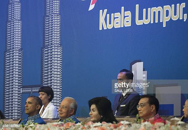Malaysia's Prime Minister Najib Razak sits alongside US President Barack Obama during the ASEAN and East Asia Summit Leaders dinner at the Kuala...