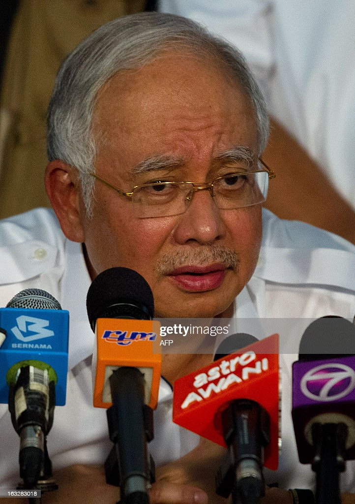 Malaysia's Prime Minister Najib Razak speaks during a press conference in Felda Sahabat in Lahad Datu on March 7, 2013 concerning the situation in Malaysia's Sabah statte where Philippine militants following a self-styled sultan recently launched a deadly incursion. Malaysia's defence minister on March 7 rejected a ceasefire offer by the self-styled Philippine sultan unless his fighters who launched a deadly incursion 'surrender unconditionally'.