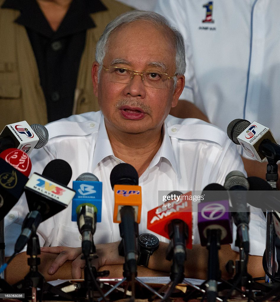 Malaysia's Prime Minister Najib Razak speaks during a press conference in Felda Sahabat in Lahad Datu on March 7, 2013 concerning the situation in Malaysia's Sabah statte where Philippine militants following a self-styled sultan recently launched a deadly incursion. Malaysia's defence minister on March 7 rejected a ceasefire offer by the self-styled Philippine sultan unless his fighters who launched a deadly incursion 'surrender unconditionally'. AFP PHOTO / MOHD RASFAN