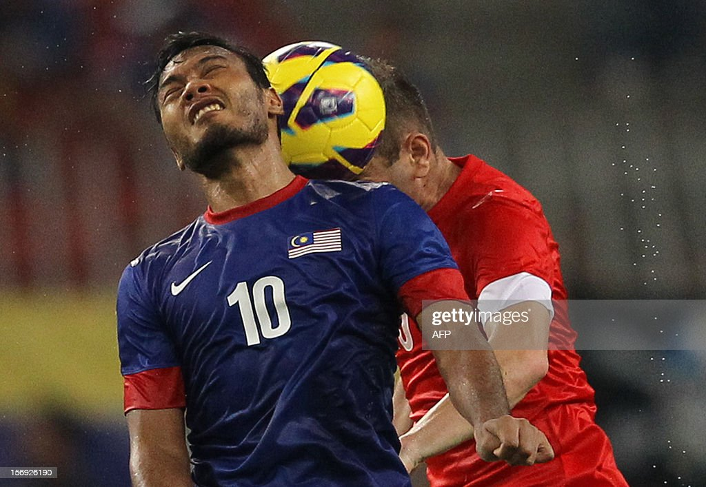 Malaysia's Safee Sali (L) fights for the ball with Singapore's Mustafic Fahrudin during their AFF Suzuki Cup group B football match against Singapore in Bukit Jalil Stadium outside Kuala Lumpur on November 25, 2012.