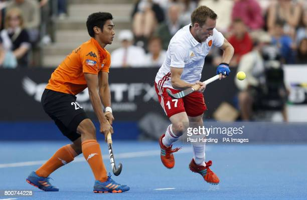 Malaysia's Sahril Saabah and England's Barry Middleton during the Men's World Hockey League Semi Final 3rd/4th place match at Lee Valley Hockey...