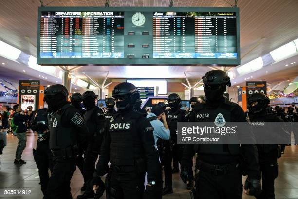 Malaysia's Special Task Force On Organised Crime arrive to provide security at the lowcost carrier Kuala Lumpur International Airport 2 during a...