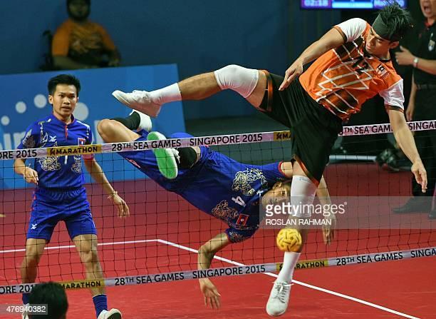 Malaysia's striker Mohd Hanafiah Dolah plays against Laos' Kantana Nanthisen during their sepak takraw men's preliminary round at the 28th Southeast...