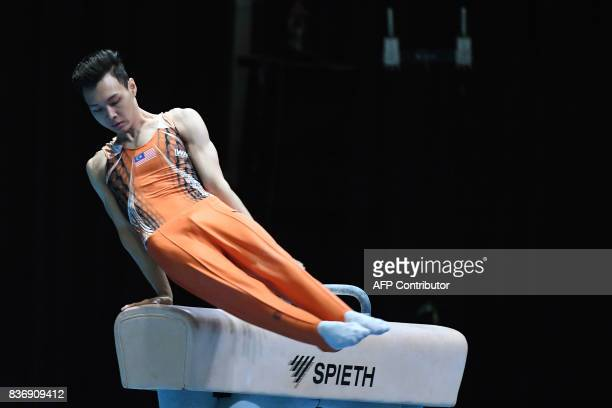 Malaysia's Tan Fu Jie competes in the men's pommel horse gymnastics event at the 29th Southeast Asian Games in Kuala Lumpur on August 22 2017 / AFP...