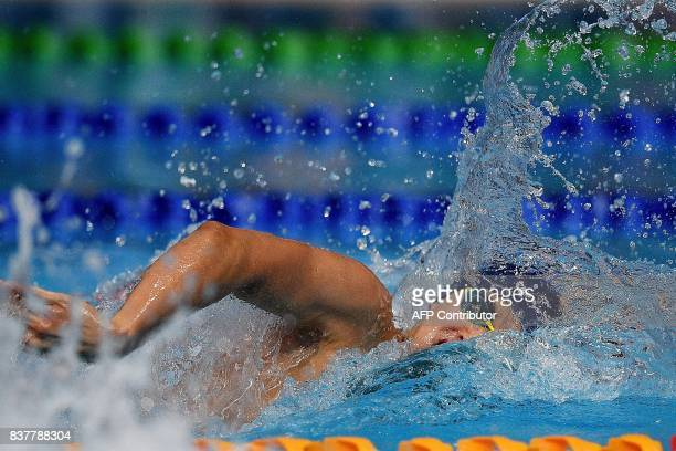 Malaysia's Welson Wee Sheng Sim competes in the men's swimming 200m freestyle final event of the 29th Southeast Asian Games at the National Aquatics...