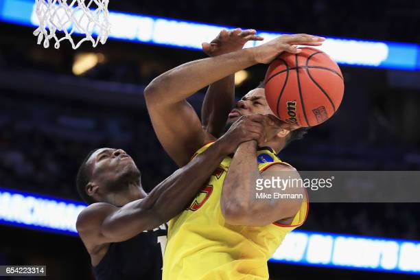 Malcolm Bernard of the Xavier Musketeers fouls Damonte Dodd of the Maryland Terrapins in the first half during the first round of the 2017 NCAA Men's...