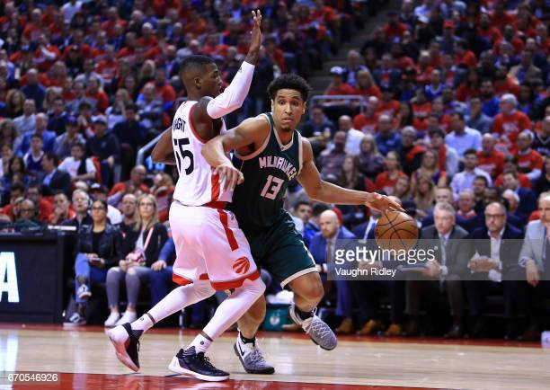 Malcolm Brogdon of the Milwaukee Bucks dribbles the ball as Delon Wright of the Toronto Raptors defends in the first half of Game Two of the Eastern...