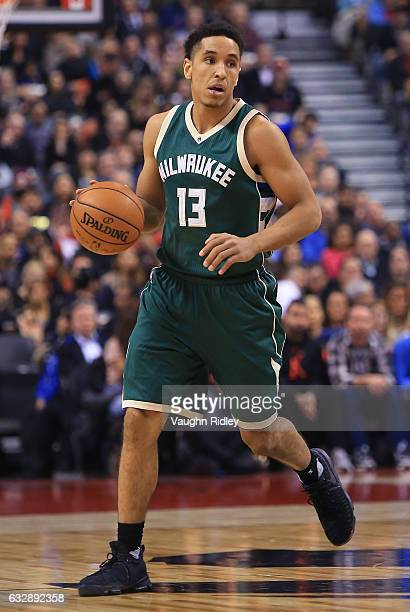 Malcolm Brogdon of the Milwaukee Bucks dribbles the ball during the first half of an NBA game against the Toronto Raptors at Air Canada Centre on...