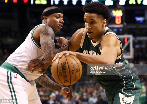 Malcolm Brogdon of the Milwaukee Bucks drives against Isaiah Thomas of the Boston Celtics during the first quarter at TD Garden on March 29 2017 in...
