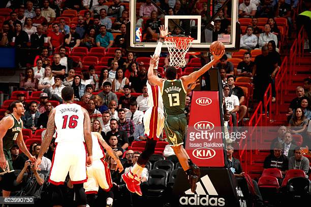 Malcolm Brogdon of the Milwaukee Bucks goes to the basket against the Miami Heat on November 17 2016 at American Airlines Arena in Miami Florida NOTE...
