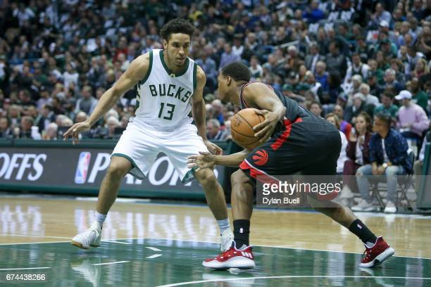 Malcolm Brogdon of the Milwaukee Bucks guards against Kyle Lowry of the Toronto Raptors in the first quarter in Game Six of the Eastern Conference...