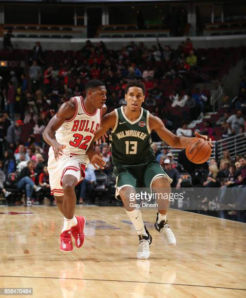 Malcolm Brogdon of the Milwaukee Bucks handles the ball against Kris Dunn of the Chicago Bulls during the preseason game on October 6 2017 at the...