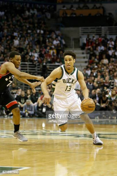 Malcolm Brogdon of the Milwaukee Bucks handles the ball against the Toronto Raptors during Game Four of the Eastern Conference Quarterfinals of the...