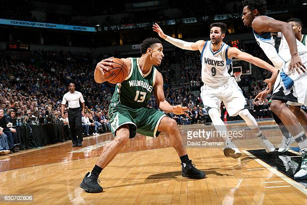 Malcolm Brogdon of the Milwaukee Bucks handles the ball during the game against the Minnesota Timberwolves on December 30 2016 at Target Center in...