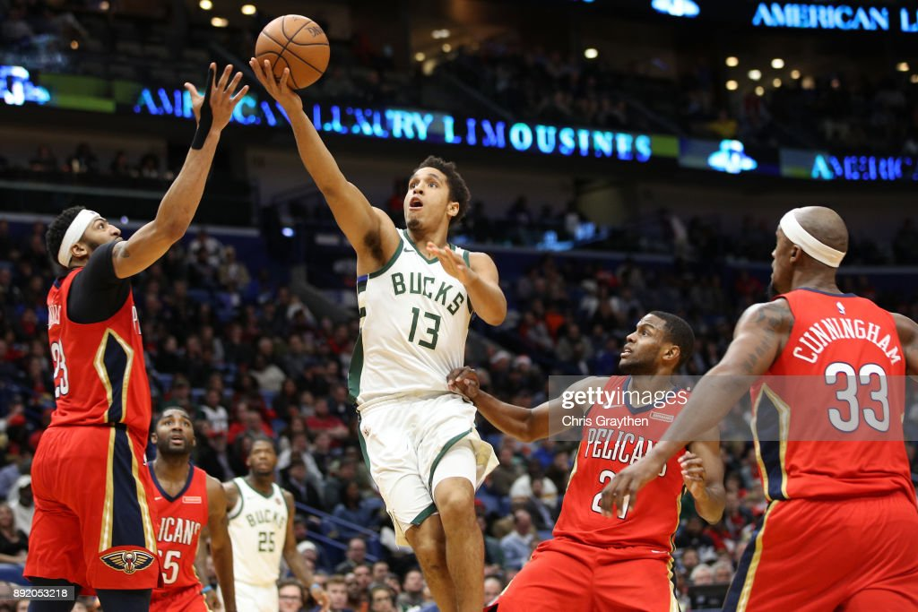 Malcolm Brogdon #13 of the Milwaukee Bucks shoots the ball over Anthony Davis #23 of the New Orleans Pelicans at Smoothie King Center on December 13, 2017 in New Orleans, Louisiana.