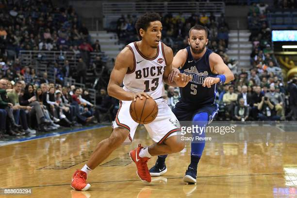 Malcolm Brogdon of the Milwaukee Bucks works against JJ Barea of the Dallas Mavericks during the first half of a game at the Bradley Center on...