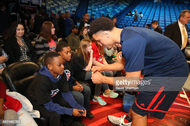 Malcolm Brogdon of the USA Team is seen with fans before the BBVA Compass Rising Stars Challenge as part of 2017 AllStar Weekend at the Smoothie King...