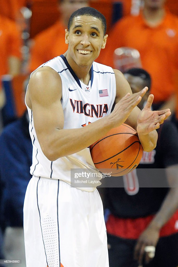 <a gi-track='captionPersonalityLinkClicked' href=/galleries/search?phrase=Malcolm+Brogdon&family=editorial&specificpeople=8768599 ng-click='$event.stopPropagation()'>Malcolm Brogdon</a> #15 of the Virginia Cavaliers celebrates a win after a college basketball game against the Louisville Cardinals at the John Paul Jones Arena on February 7, 2015 in Charlottesville, Virginia. The Cavaliers won 52-47.