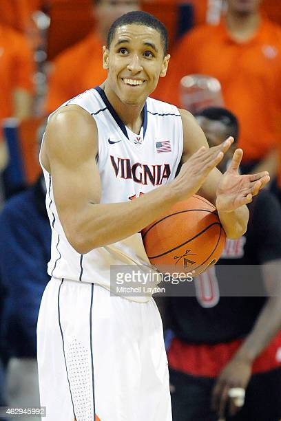 Malcolm Brogdon of the Virginia Cavaliers celebrates a win after a college basketball game against the Louisville Cardinals at the John Paul Jones...