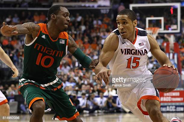 Malcolm Brogdon of the Virginia Cavaliers dribbles in front of Sheldon McClellan of the Miami Hurricanes during the first half in the semifinals of...