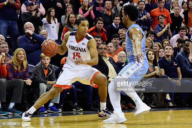Malcolm Brogdon of the Virginia Cavaliers dribbles the ball against Joel Berry II of the North Carolina Tar Heels in the second half during their...