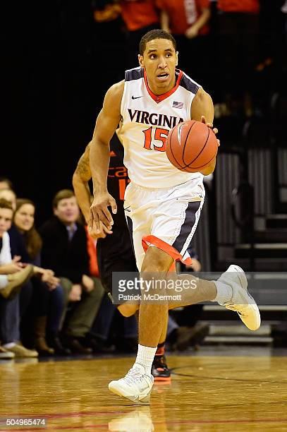 Malcolm Brogdon of the Virginia Cavaliers dribbles the ball in the second half during a game against the Miami Hurricanes at John Paul Jones Arena on...