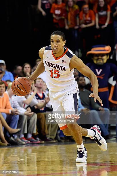 Malcolm Brogdon of the Virginia Cavaliers dribbles the ball in the second half during their game against the North Carolina Tar Heels at John Paul...