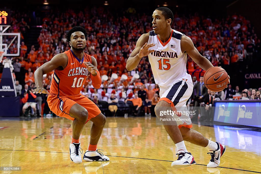 <a gi-track='captionPersonalityLinkClicked' href=/galleries/search?phrase=Malcolm+Brogdon&family=editorial&specificpeople=8768599 ng-click='$event.stopPropagation()'>Malcolm Brogdon</a> #15 of the Virginia Cavaliers dribbles the ball past Gabe DeVoe #10 of the Clemson Tigers in the second half during a game at John Paul Jones Arena on January 19, 2016 in Charlottesville, Virginia. The Virginia Cavaliers defeated the Clemson Tigers 69-62.