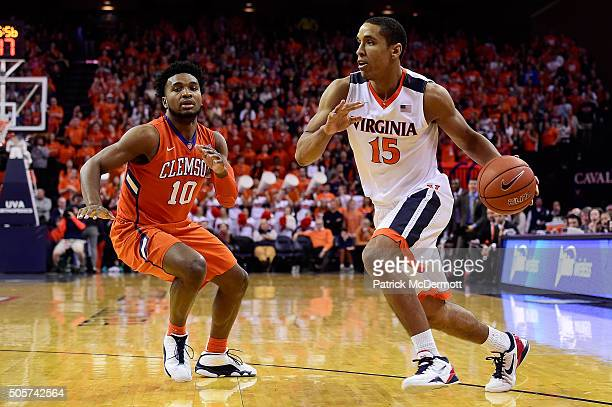 Malcolm Brogdon of the Virginia Cavaliers dribbles the ball past Gabe DeVoe of the Clemson Tigers in the second half during a game at John Paul Jones...