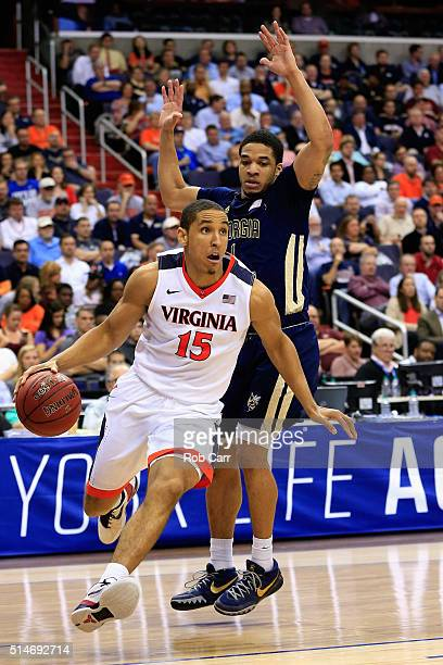 Malcolm Brogdon of the Virginia Cavaliers drives around Tadric Jackson of the Georgia Tech Yellow Jackets in the second half during the quarterfinals...