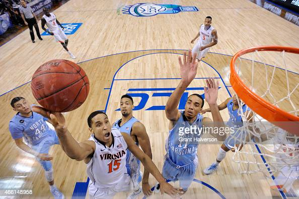 Malcolm Brogdon of the Virginia Cavaliers drives to the basket against Brice Johnson of the North Carolina Tar Heels during the semifinals of the...