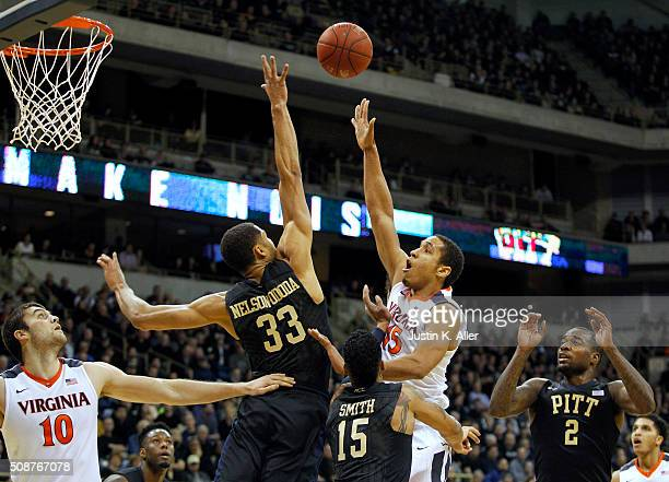 Malcolm Brogdon of the Virginia Cavaliers pulls up for a shot against Alonzo NelsonOdoda of the Pittsburgh Panthers during the game at Petersen...