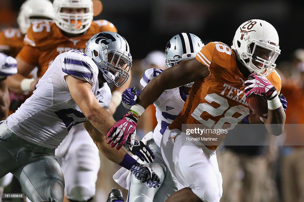 Malcolm Brown #28 of the Texas Longhorns runs the ball against Jonathan Truman #21 of the Kansas State Wildcats at Darrell K Royal-Texas Memorial Stadium on September 21, 2013 in Austin, Texas.