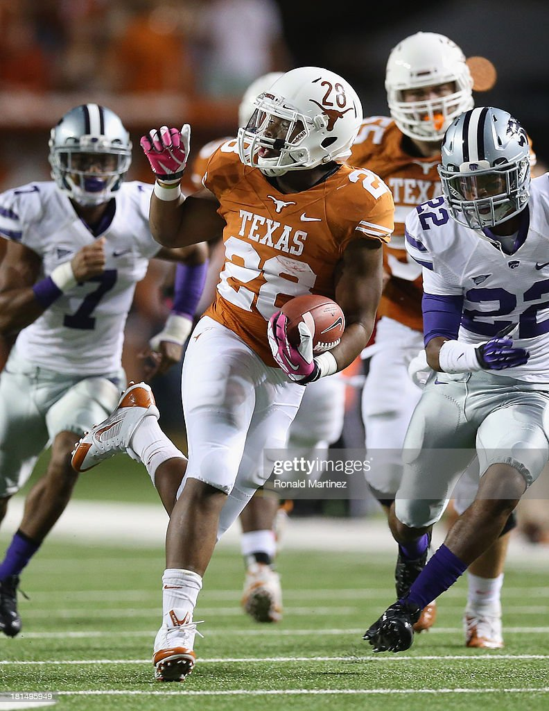 Malcolm Brown #28 of the Texas Longhorns runs the ball against the Kansas State Wildcats at Darrell K Royal-Texas Memorial Stadium on September 21, 2013 in Austin, Texas.