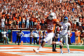 Malcolm Brown of the Texas Longhorns scores a touchdown against the Kansas Jayhawks during a game at Darrell K RoyalTexas Memorial Stadium on...