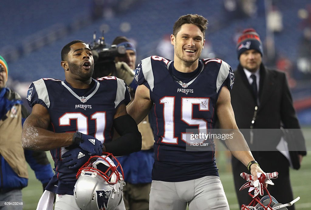 Malcolm Butler #21 and Chris Hogan #15 of the New England Patriots react as they walk off the field after defeating the Baltimore Ravens 30-23 at Gillette Stadium on December 12, 2016 in Foxboro, Massachusetts.