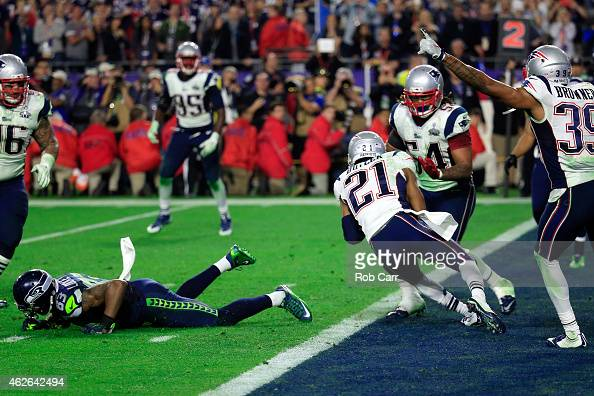 Malcolm Butler of the New England Patriots intercepts a pass by Russell Wilson of the Seattle Seahawks late in the fourth quarter during Super Bowl...