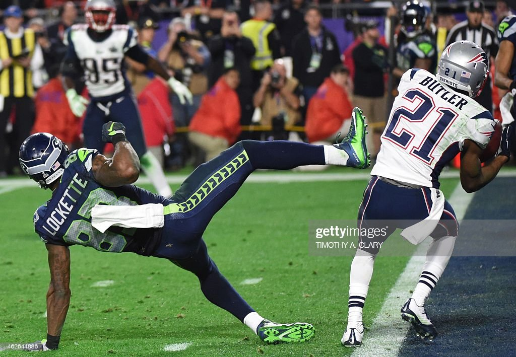 Malcolm Butler of the New England Patriots intercepts a pass intended for Ricardo Lockette of the Seattle Seahawks late in the fourth quarter of...