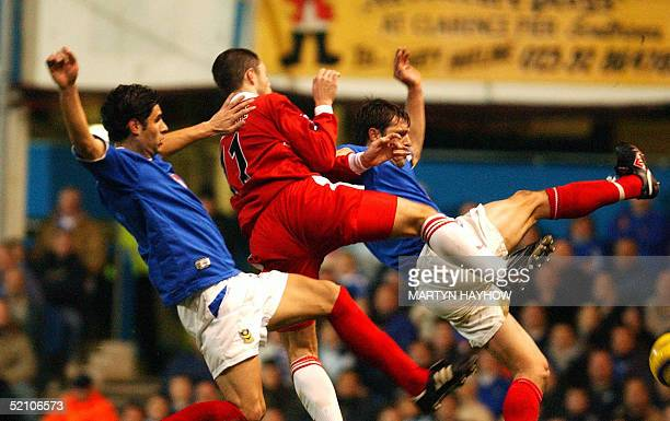Malcolm Christie of Middlesborough vies with Portsmouth's Dejan Stefanovic and Arjan de Zeeuw 02 February 2005 during their football match in...