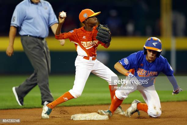 Malcolm Deason of the Southwest team from Texas turns a double play during Game 4 of the 2017 Little League World Series against the Great Lakes team...