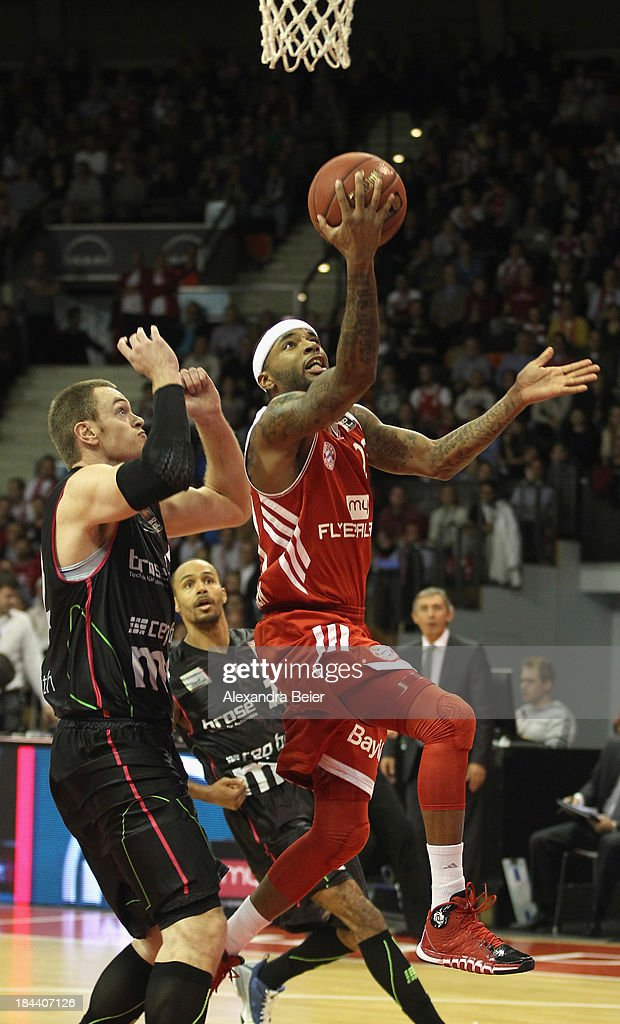 Malcolm Delaney of Bayern Muenchen throws a ball against Tim Brauner of medi Bayreuth during the Basketball Bundesliga match between FC Bayern...
