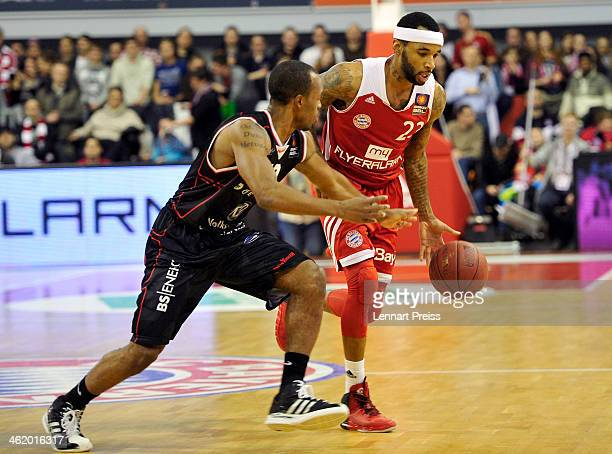 Malcolm Delaney of Muenchen challenges James Florence of Braunschweig during the Beko Basketball Bundesliga match between FC Bayern Muenchen and New...