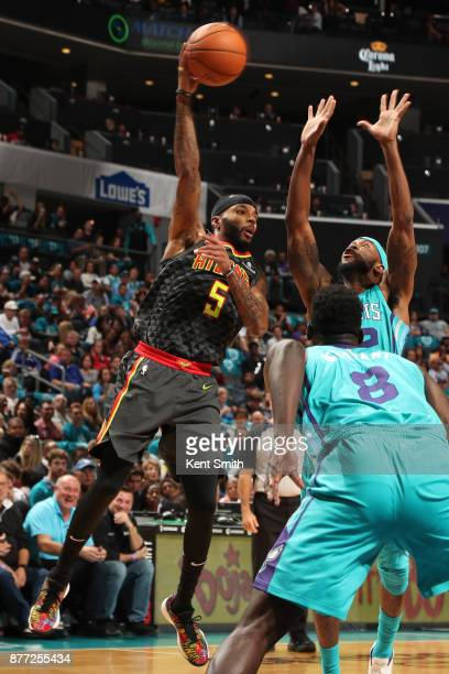 Malcolm Delaney of the Atlanta Hawks looks to pass against the Charlotte Hornets on October 20 2017 at Spectrum Center in Charlotte North Carolina...