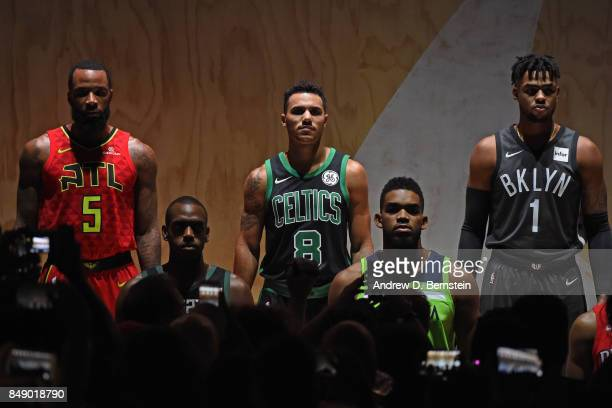 Malcolm Delaney of the Atlanta Hawks Shane Larkin of the Boston Celtics and D'Angelo Russell of the Brooklyn Nets help unveil new uniforms during the...