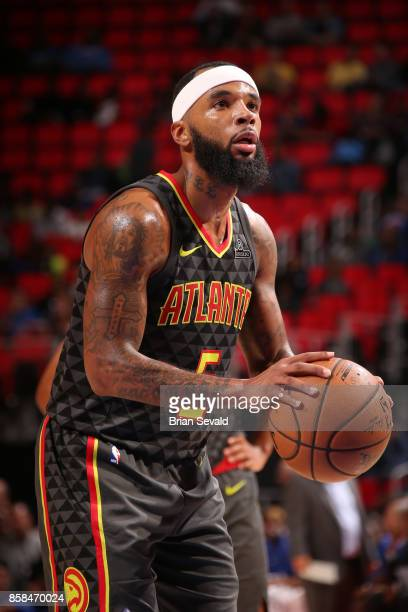 Malcolm Delaney of the Atlanta Hawks shoots a free throw against the Detroit Pistons on October 6 2017 at Little Caesars Arena in Detroit Michigan...