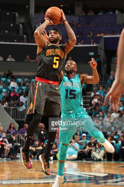 Malcolm Delaney of the Atlanta Hawks shoots the ball during the game against the Charlotte Hornets on October 20 2017 at Spectrum Center in Charlotte...