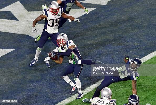 Malcolm Dutler of the New England Patriots intercepts the pass at the goal line late in the fourth quarter against the Seattle Seahawks during Super...